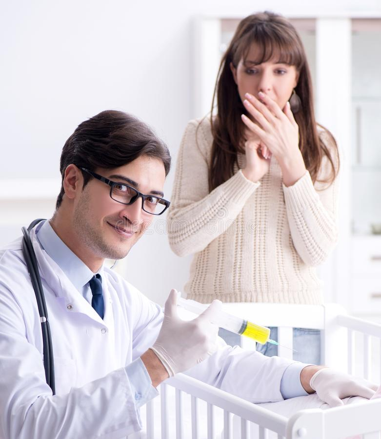 Doctor explaining to young mother. The doctor explaining to young mother royalty free stock photo