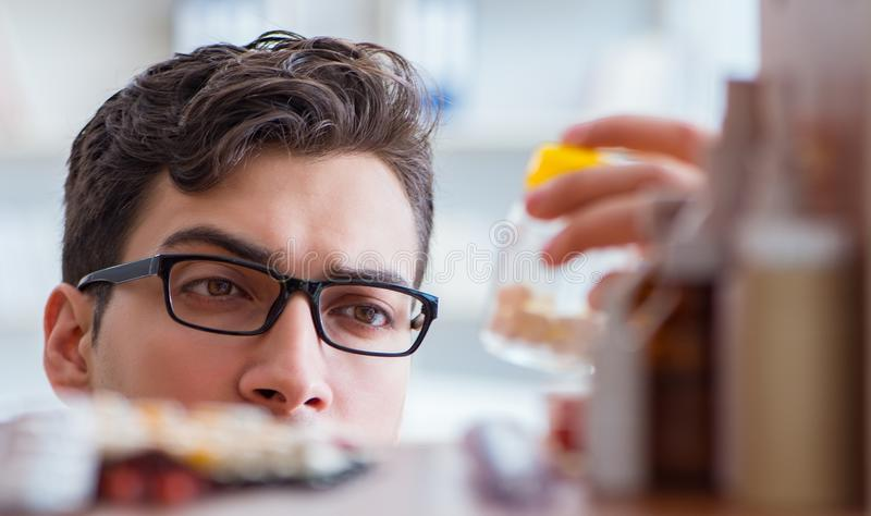 Doctor at farmacy retail shop looking for medicines. The doctor at farmacy retail shop looking for medicines stock images