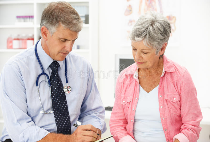 Download Doctor with female patient stock image. Image of doctor - 19904953