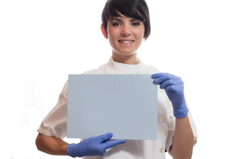 Doctor 6. Female doctor smiles and holding a label royalty free stock photography