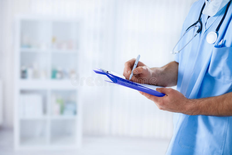 Doctor filling medical form royalty free stock photos