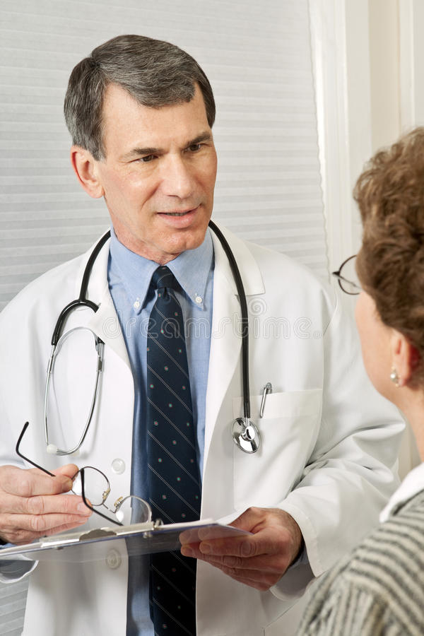 Doctor Gives Female Patient Good News Royalty Free Stock Photography