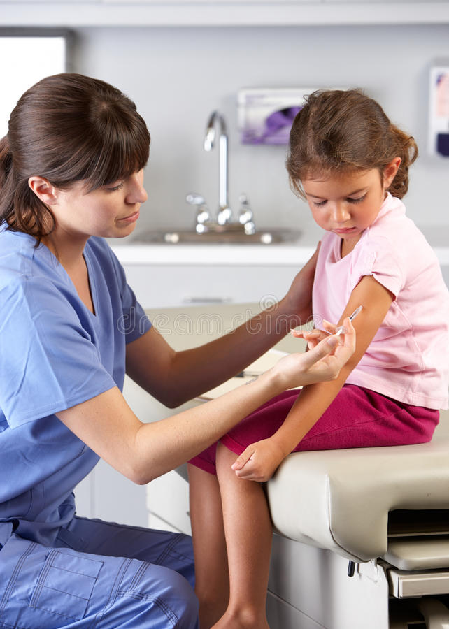 Download Doctor Giving Child Injection In Doctor's Office Stock Photo - Image: 28851292