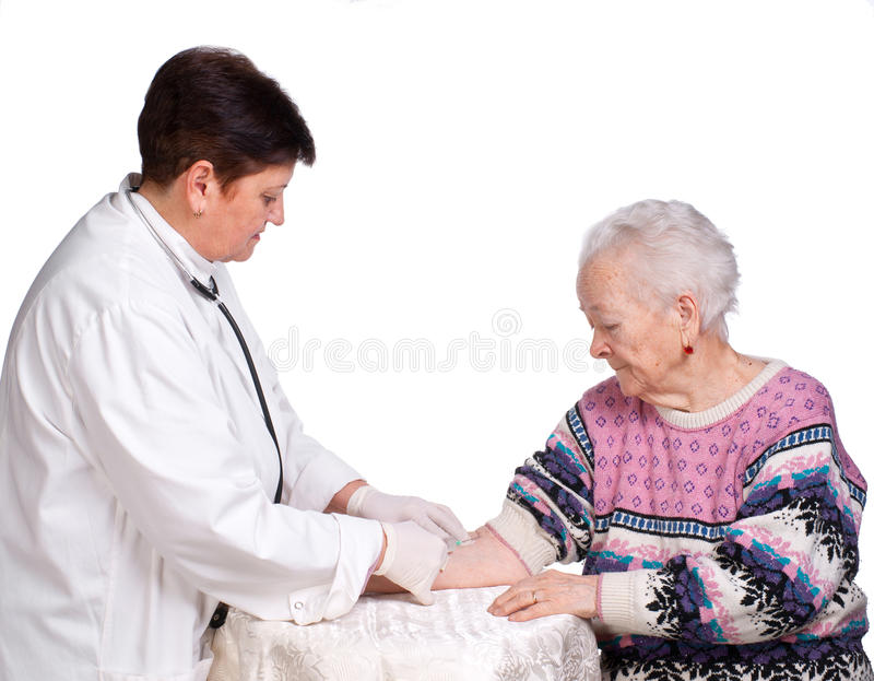 Doctor Giving Injection To Old Woman Royalty Free Stock Image