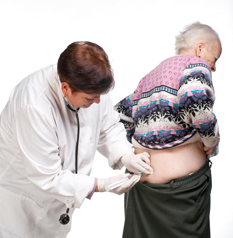 Download Doctor Giving Injection To Old Woman Stock Image - Image: 29340039