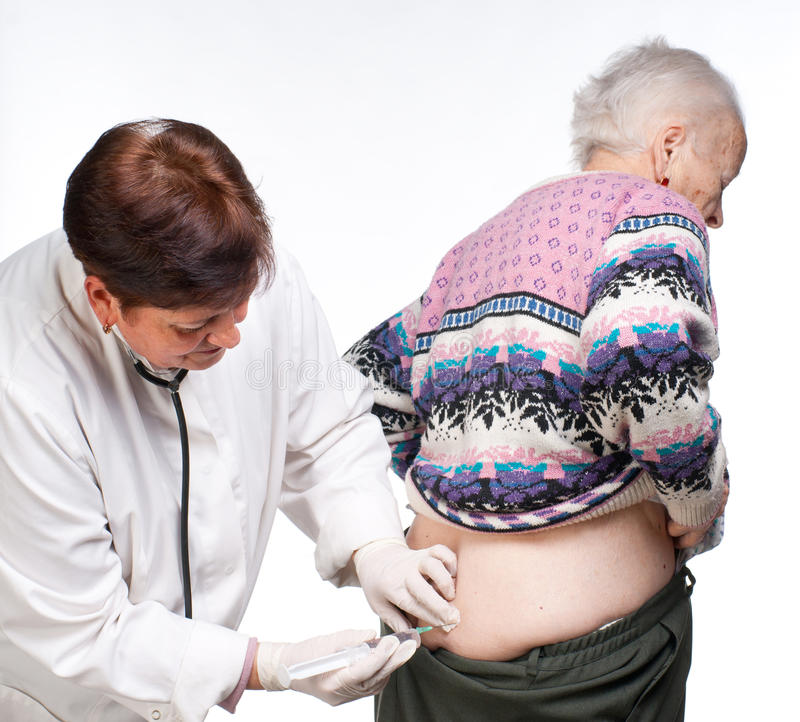 Doctor Giving Injection To Old Woman Stock Photos
