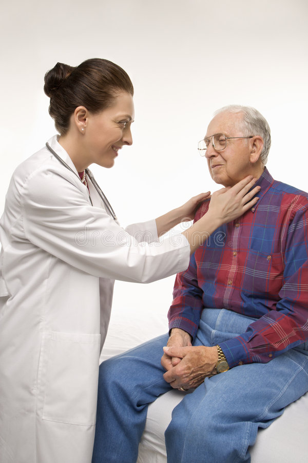 Doctor giving man check-up royalty free stock image
