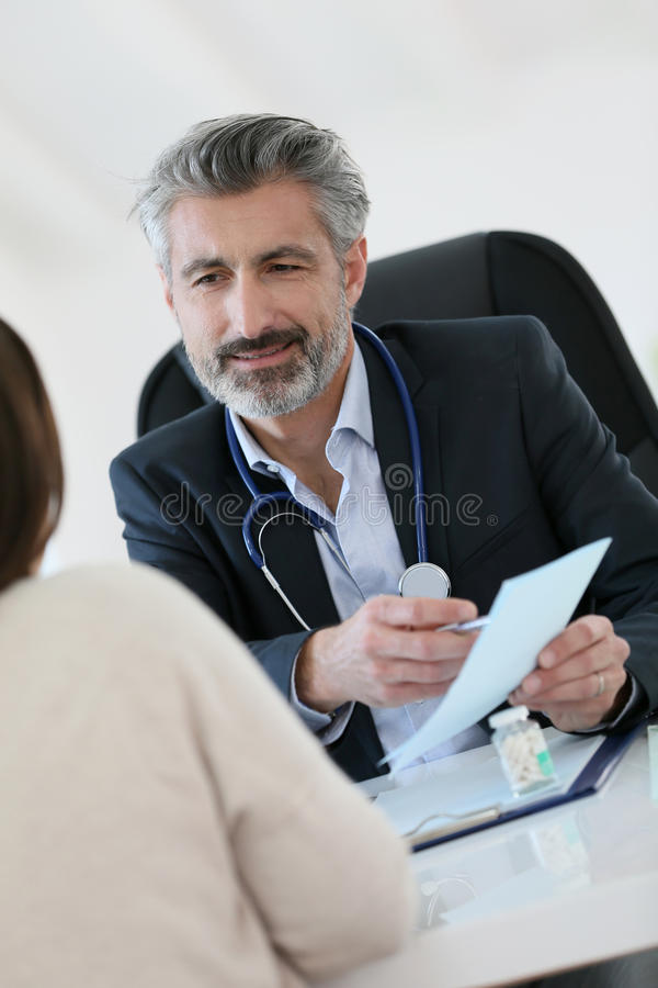 Doctor giving medical prescription to patient royalty free stock photo