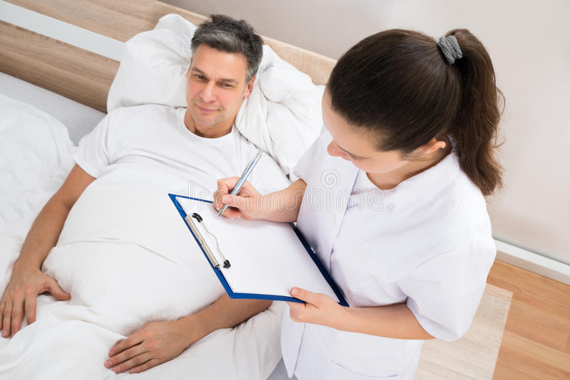 Doctor giving prescription to patient royalty free stock photo