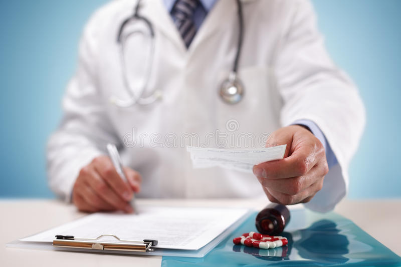 Doctor giving a prescription to a patient royalty free stock photos