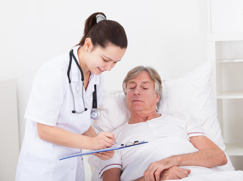 Doctor giving prescriptions royalty free stock image