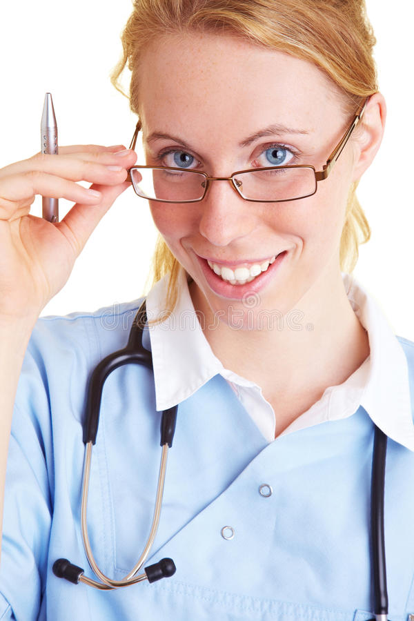 Doctor with glasses. Blonde doctor with glasses and a ballpoint pen stock image