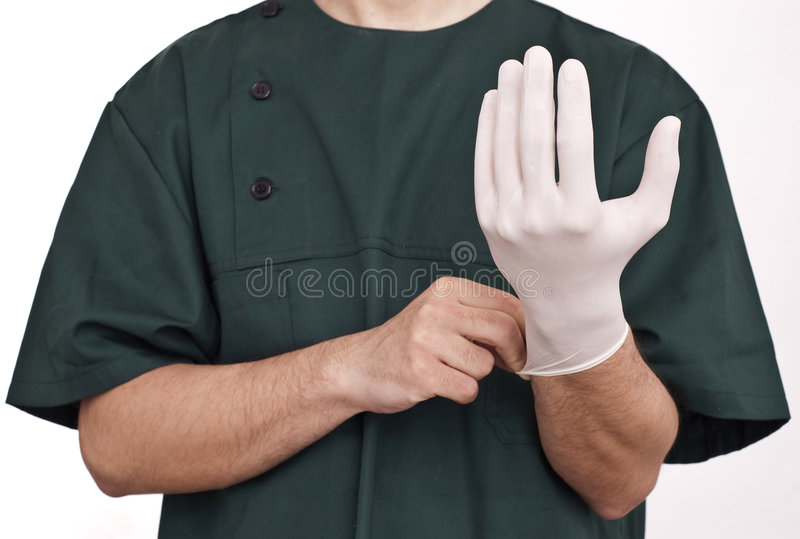 Doctor with glove stock photos