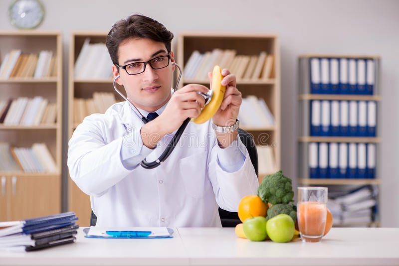The doctor in gmo food concept stock photos