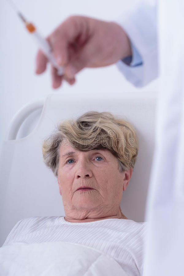 Doctor going to do injection stock photography