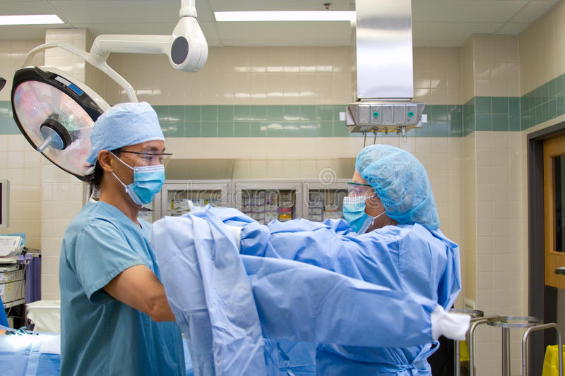 Doctor gowning for surgery royalty free stock photos