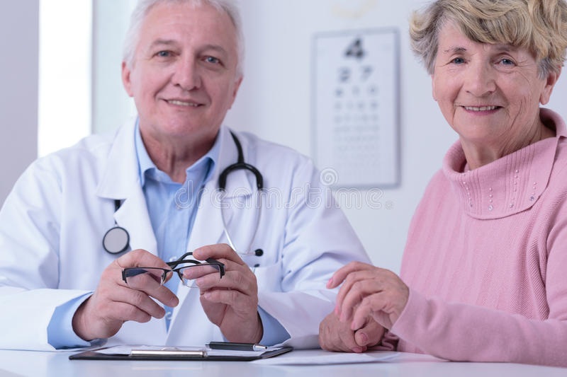 Doctor and grateful patient stock image