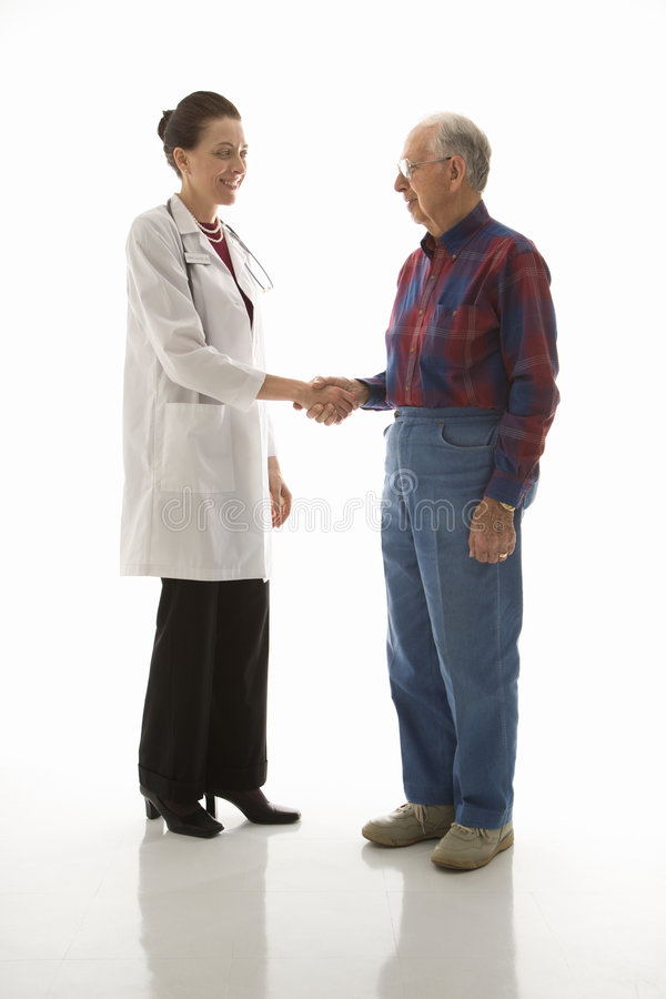Doctor greeting patient stock image