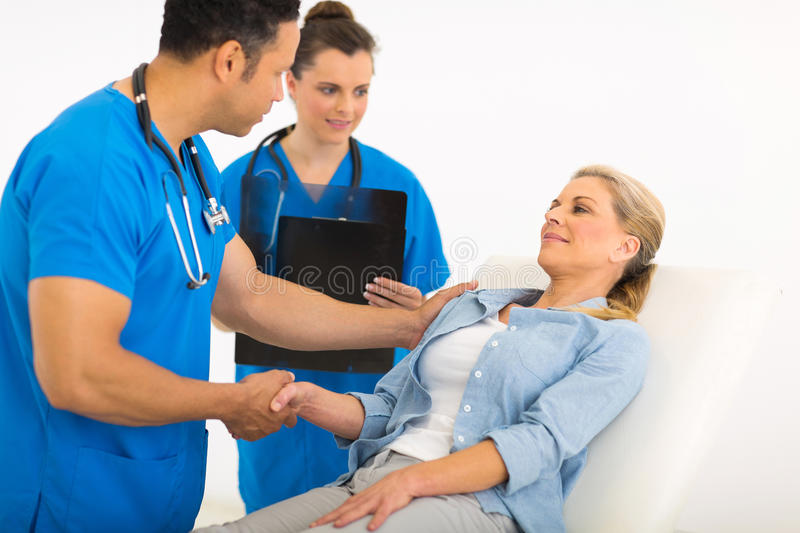 Doctor greeting patient royalty free stock photos