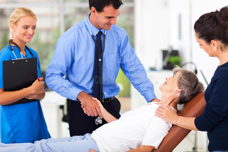 Doctor greeting senior patient royalty free stock image