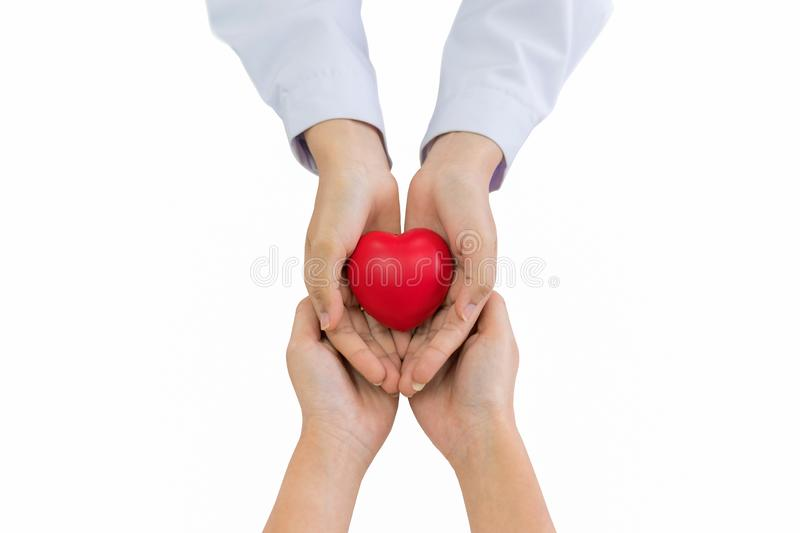Doctor hands holding red heart with patient, health care love, give, hope and family insurance concept. Doctor hands holding red heart with patient isolated on royalty free stock image