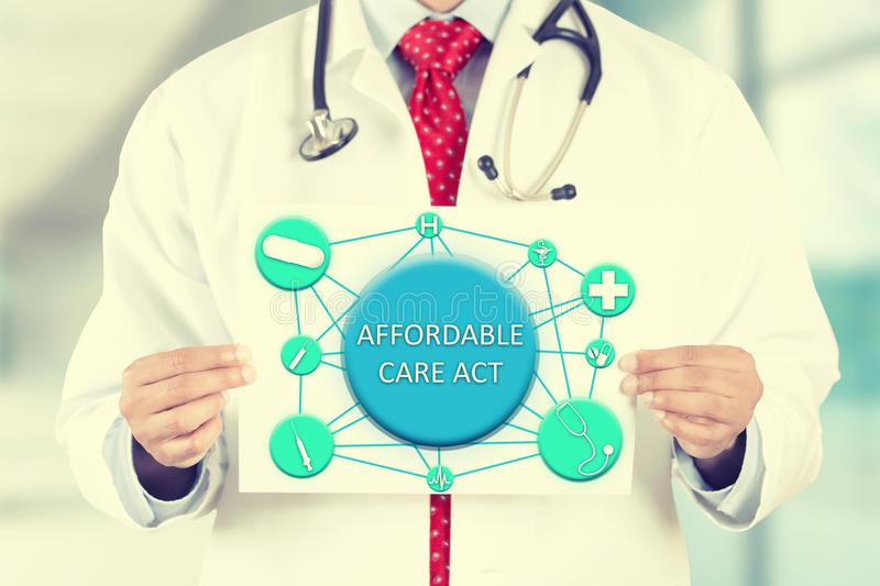 Doctor hands holding white card sign with affordable care act text message stock images