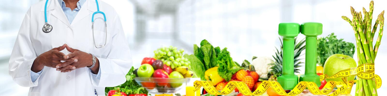 Doctor hands. Over fruits and vegetables background stock images