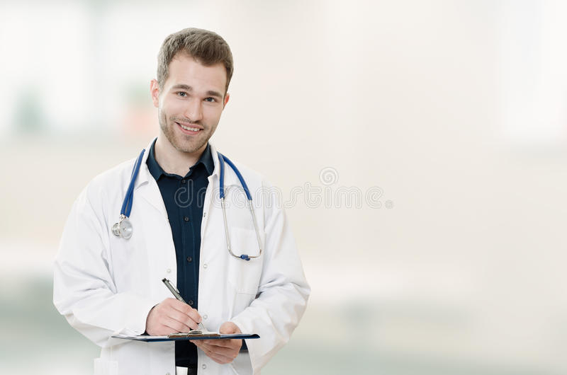 Doctor with hands in pocket on blurred background. Copyspace med royalty free stock images