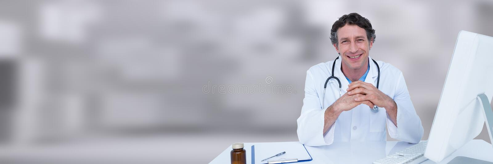 Doctor hands together at desk against white blurred background. Digital composite of Doctor hands together at desk against white blurred background royalty free stock image