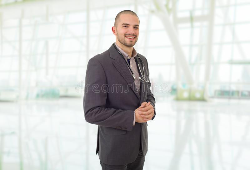 Doctor. Happy male doctor, at the hospital stock image