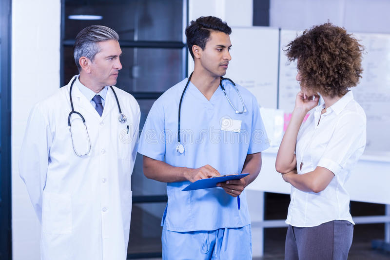 Doctor having a discussion with colleagues. In hospital stock photo