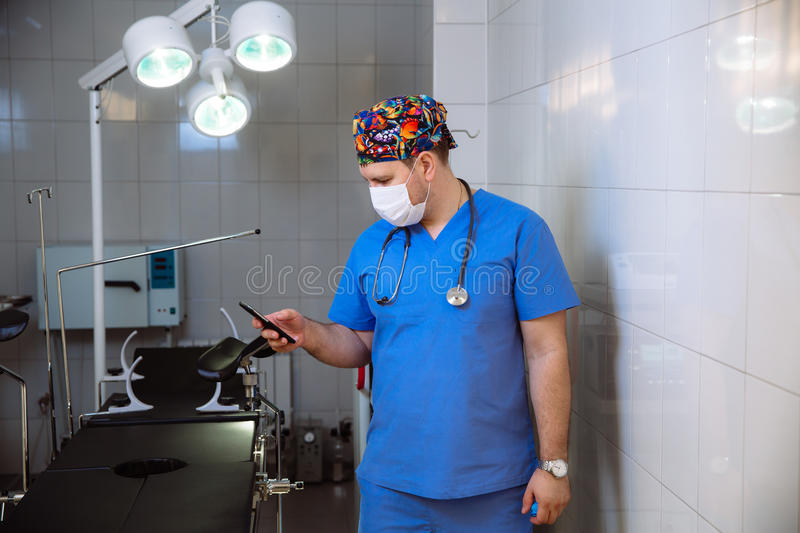 Doctor having phone call at his medical office. Concept of a hospital royalty free stock photography