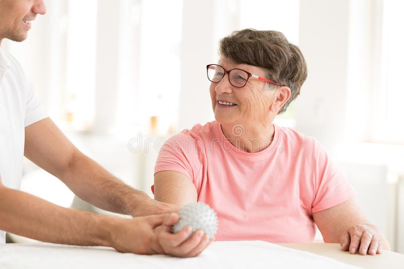 Older woman in hand physiotherapy stock photo