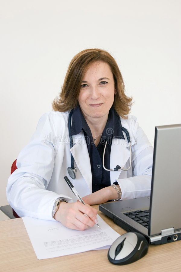 Doctor at her desk royalty free stock image