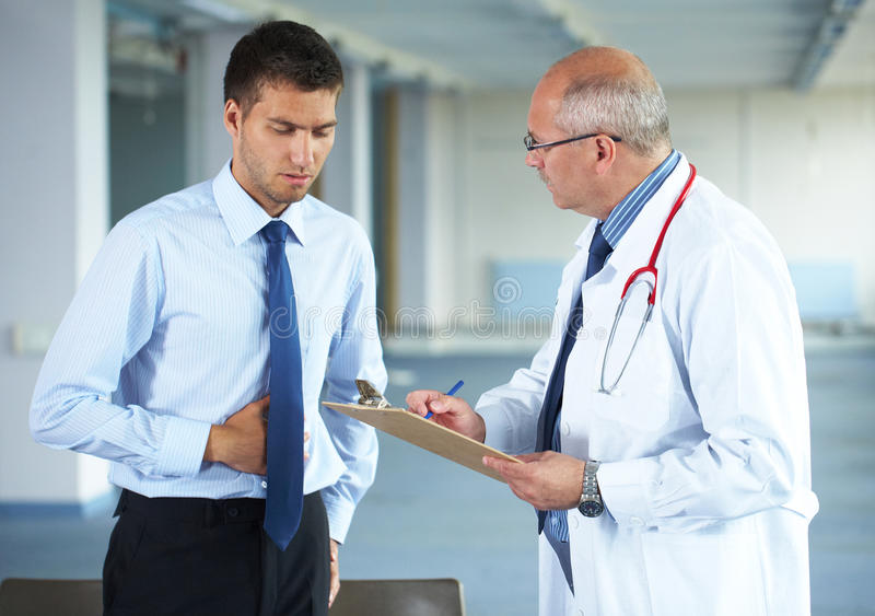 Doctor and his patient, indoor shoot royalty free stock photo