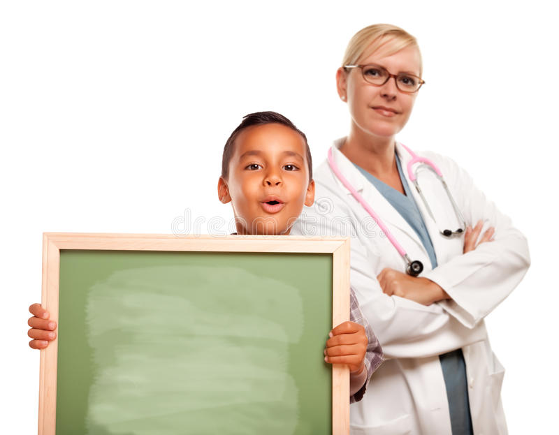 Doctor with Hispanic Child Holding Chalk Board stock photo