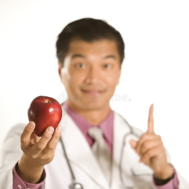 Doctor holding apple. royalty free stock photography