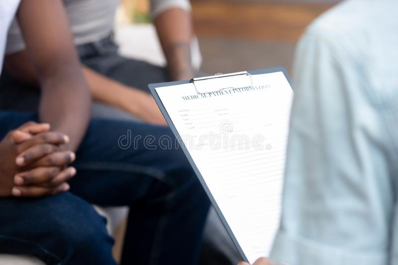 Doctor holding binder with patient medical card stock photography