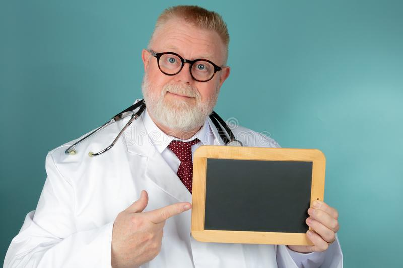 Doctor holding blank chalkboard stock photos
