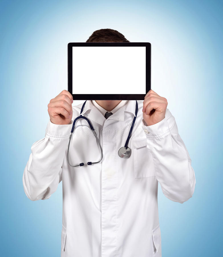 Doctor holding blank tablet royalty free stock images