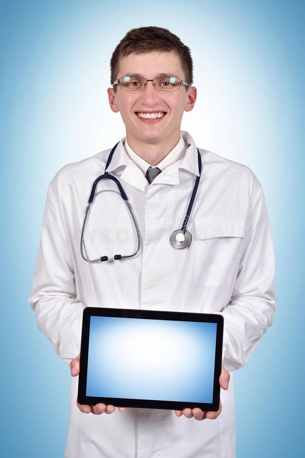 Doctor holding blank tablet royalty free stock photography