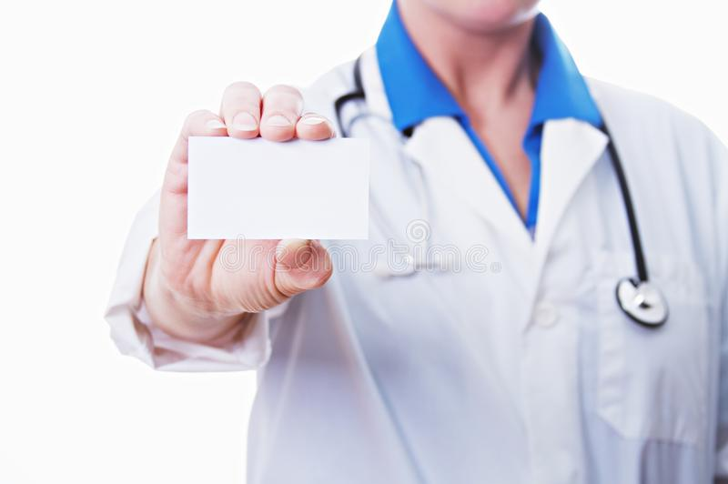 A doctor holding a business card stock photography