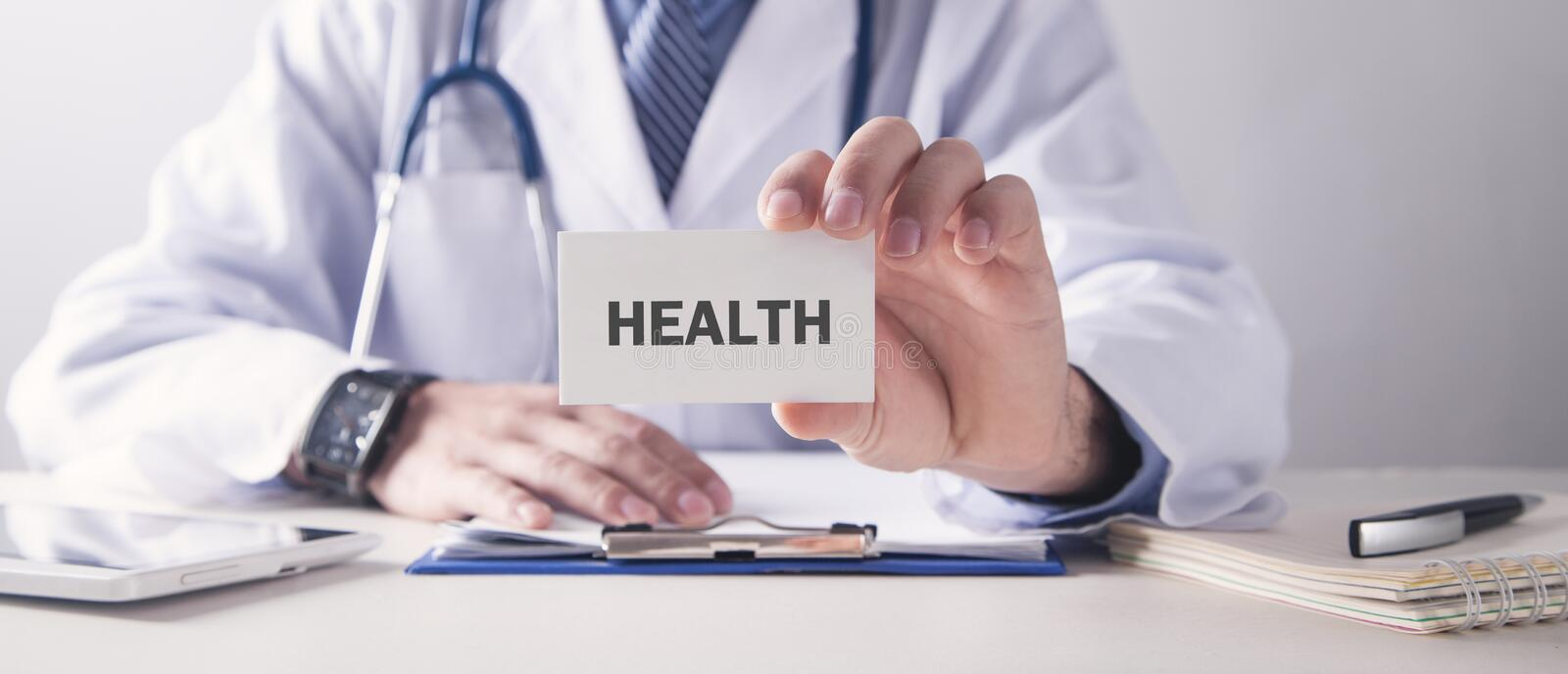 Doctor holding business card. Health royalty free stock images