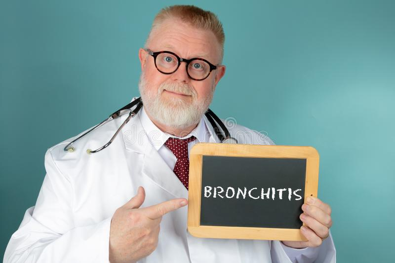 Doctor holding chalkboard with Bronchitis lettering stock images