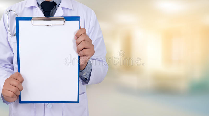 doctor holding a clipboard Hands of Health care medical backgro royalty free stock photography