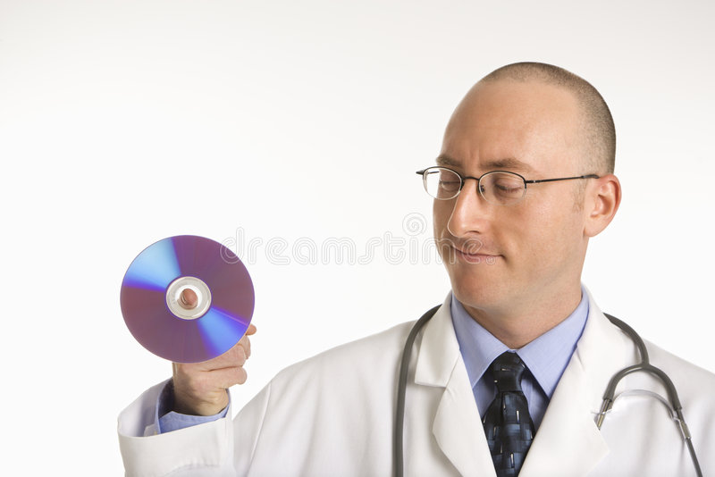 Doctor holding compact disc. royalty free stock image