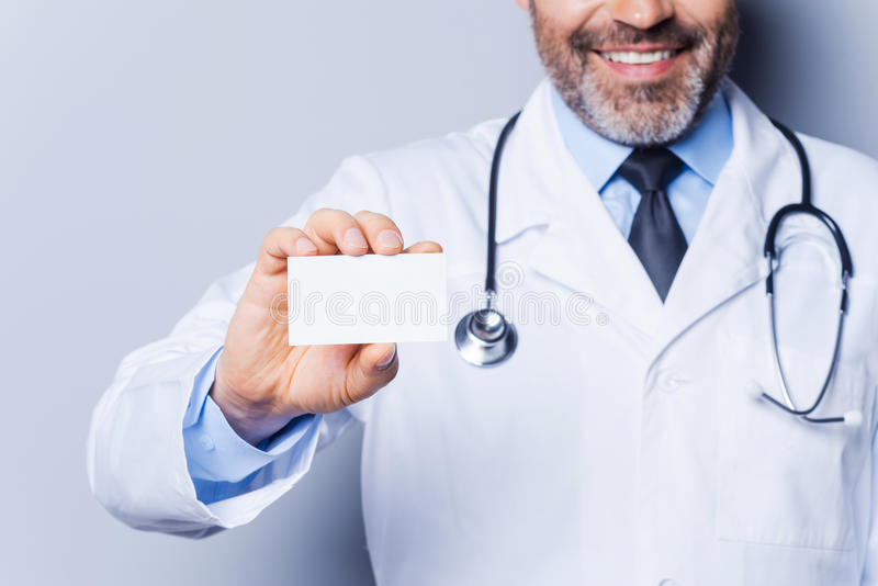 Doctor holding copy space. royalty free stock photography