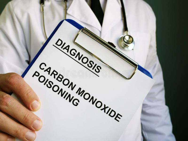 Doctor holds diagnosis Carbon monoxide poisoning. Doctor is holding diagnosis Carbon monoxide poisoning royalty free stock images