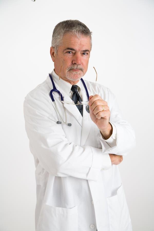 Doctor holding eyeglasses stock photo