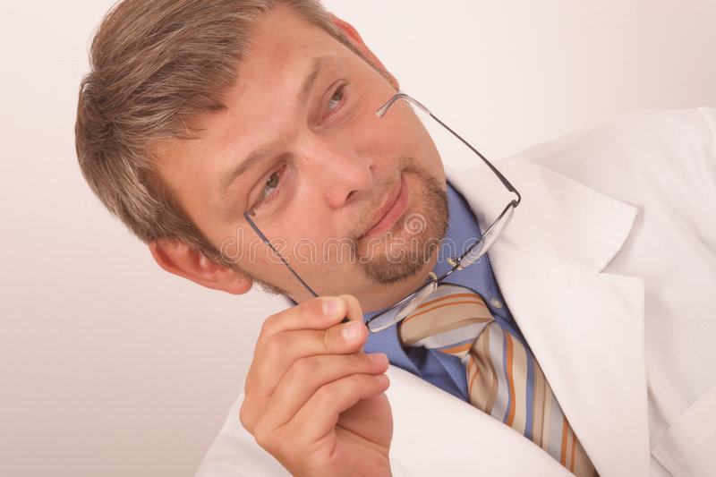 Doctor holding eyeglasses royalty free stock images